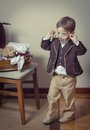 Vintage portrait of boy playing with old glasses cute little antique found in a case retro style concept Royalty Free Stock Photos