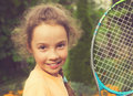 Vintage portrait of cute girl playing tennis in summer Royalty Free Stock Photo