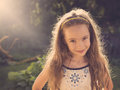 Vintage portrait of happy little girl having fun at the park cute Stock Image