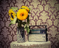 Vintage radio and sunflowers on the table Royalty Free Stock Photos
