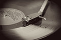 Vintage record player with spinning vinyl Royalty Free Stock Photo