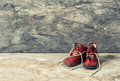 Vintage red baby shoes. retro style toned picture Royalty Free Stock Photo