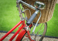 Vintage a red bicycle with weaving basket infront Royalty Free Stock Photos