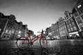 Vintage red bike on cobblestone historic old town in rain. Wroclaw, Poland. Royalty Free Stock Photo