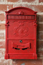Vintage red metal mail box on a brick wall Stock Images