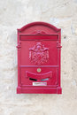 Vintage red metal mail box on the plaster wall Stock Photography