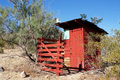 Vintage Red Outhouse in The Desert Royalty Free Stock Photo