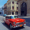 Vintage red taxi car havana cuba on the street of old city Royalty Free Stock Photos