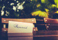 Vintage reserved restaurant table styled image of a sign on a at an outdoor Stock Image