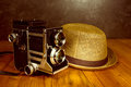 Vintage retro camera with fedora hat Royalty Free Stock Photo