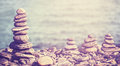 Vintage retro hipster style image of stones on beach. Royalty Free Stock Photo