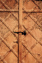 Vintage retro rusty steel door background Stock Image