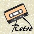 Vintage retro 80s audio cassette on grunge background
