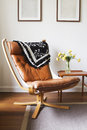 Vintage retro tan leather danish chair and table Royalty Free Stock Photo