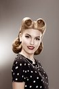 Vintage. Retro Woman in Stylish Polka Dot Dress Portrait - Pin Up Royalty Free Stock Photo