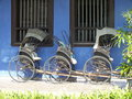 Vintage Rickshaw outside of the Blue Mansion located in Georgetown, Malaysia Royalty Free Stock Photo