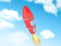 Vintage rocket red fly in the sky Stock Photos