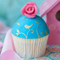 Vintage rose cupcake decorated with a pink sugar Stock Photos