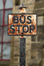 Vintage rusted bus stop sign poster Stock Photos