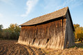 Vintage rustical barn an old wooden farm building in the middle of a field Royalty Free Stock Photography
