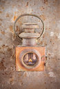 Vintage rusty lantern on a rusted steel background with flame Stock Photography