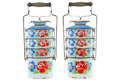 Vintage rusty metal food tiffin carrier in white with colorful f flowers isolated on background Stock Photography