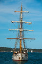 Vintage sailing ship gets ready to sail her berth harbor Royalty Free Stock Photos