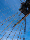 Vintage sailing ship mast and rigging of a historic viewed from below against a blue sky santissima trinidad alicante spain Royalty Free Stock Images