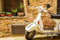 Vintage scene with vespa on old street italy Stock Photo