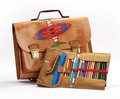 Vintage school bag and pencil case leather decorated with a flying saucer an open displaying a set of colorful crayons Royalty Free Stock Images
