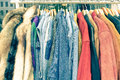 Vintage second hand clothes hanging on shop rack at flea market Royalty Free Stock Photo