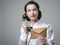 Vintage secretary on the phone with envelope Royalty Free Stock Photo