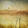 Vintage sepia landscape with paragliding in flight Royalty Free Stock Photo
