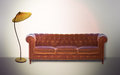 Vintage settee and lamp in sepia Stock Photography