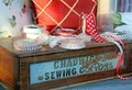 Vintage sewing collection photo of a wooden box with ribbons and cushions the name chadwicks cottons is on front of box photo Royalty Free Stock Image