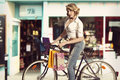 Vintage sexy girl shopping with bicycle eco friendly on some bags in summer time she wearing shirt and jeans in color Royalty Free Stock Photos