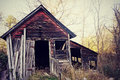 Vintage shed an old run down antique retro red wooden in the countryside in wisconsin Royalty Free Stock Image