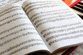 Open music book on a keyboard instrument Royalty Free Stock Photo