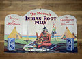 Vintage sign on a wall an old tin advertising indian root pills display at the cradle of forestry in north carolina Stock Photo