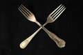 Vintage silver flatware ancient on a black background Royalty Free Stock Photography