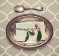 Vintage silver platter and spoon place setting Royalty Free Stock Photo