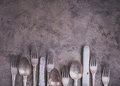Vintage silverware from bottom side of grunge background Royalty Free Stock Photo