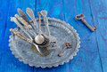Vintage silverware on rustic metal plate on old wooden background Royalty Free Stock Images