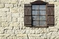 Vintage Single Window  with Wooden Shutters on Natural Stone Wal Royalty Free Stock Photo
