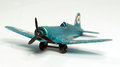 Vintage small toy fighter plane miniature war Stock Photo