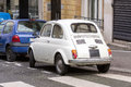 Vintage small white Fiat 500 car back view Royalty Free Stock Photo