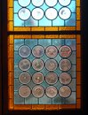 Vintage stained-glass window in old castle interior Royalty Free Stock Photo
