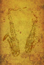 Vintage stamps of two saxophones on old paper Stock Photos