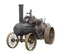 Vintage steam engine tractor isolated. Royalty Free Stock Photo