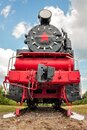 Vintage steam train on the rails close-up on blue sky background, retro vehicle, steam engine Royalty Free Stock Photo